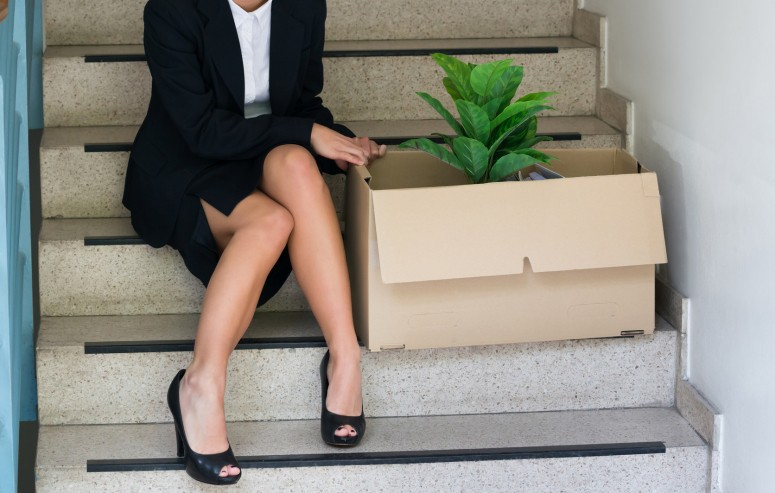 Businesswoman-With-Belongings-Sitting-On-Steps-At-Office-600670398_2124x1418_cropped.jpg