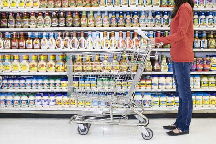 Shopper-checking-list-in-supermarket-aisle-517974032_3869x2579.jpeg