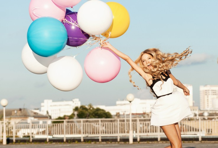 Resized_Happy-young-woman-with-colorful-latex-balloons-457080187_1733x1733.jpg