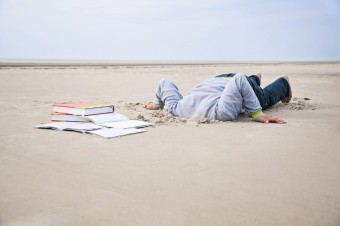 Overstrained-child-stucks-head-in-sand-168729460_2128x1413.jpeg