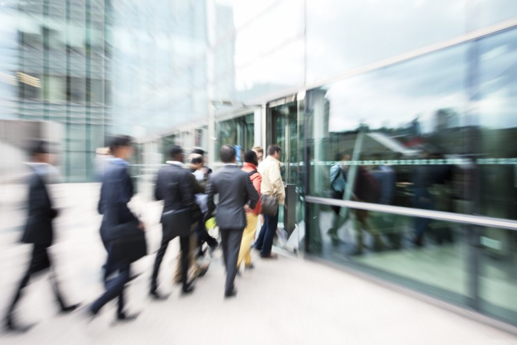 Blurred-Business-People-Entering-Office-Building-Through-Glass-Doors-171583116_2122x1415.jpeg