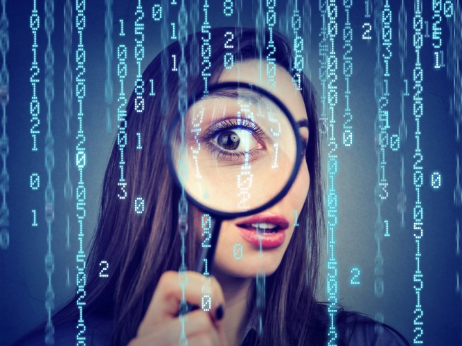 Investigation-surveillance-of-cyber-crime-concept.-Curious-woman-looking-through-a-magnifying-glass-